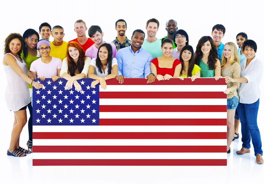 Large Group of People Holding American Flag Board